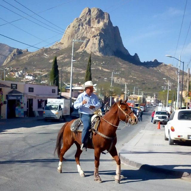 Running into a traditional cabalgata a leisurely horse riding paradehellip
