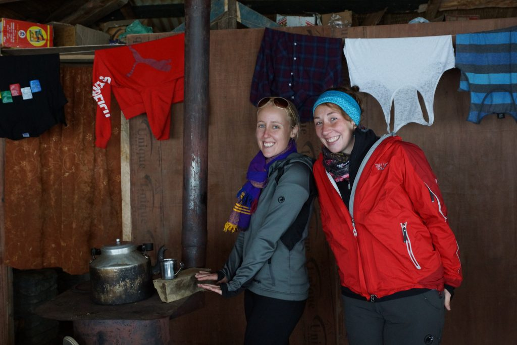 Warming up next to the fire with milk tea at High Camp on Mardi Himal Trek in Nepal