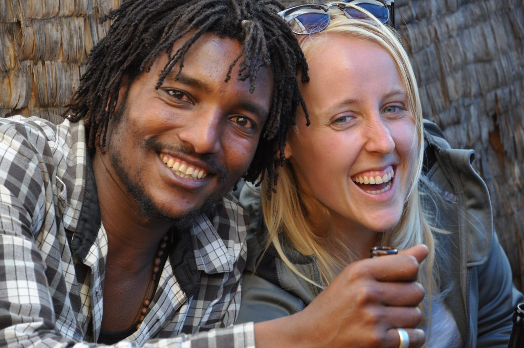 A picture of me with my blond hair next to an Ethiopian