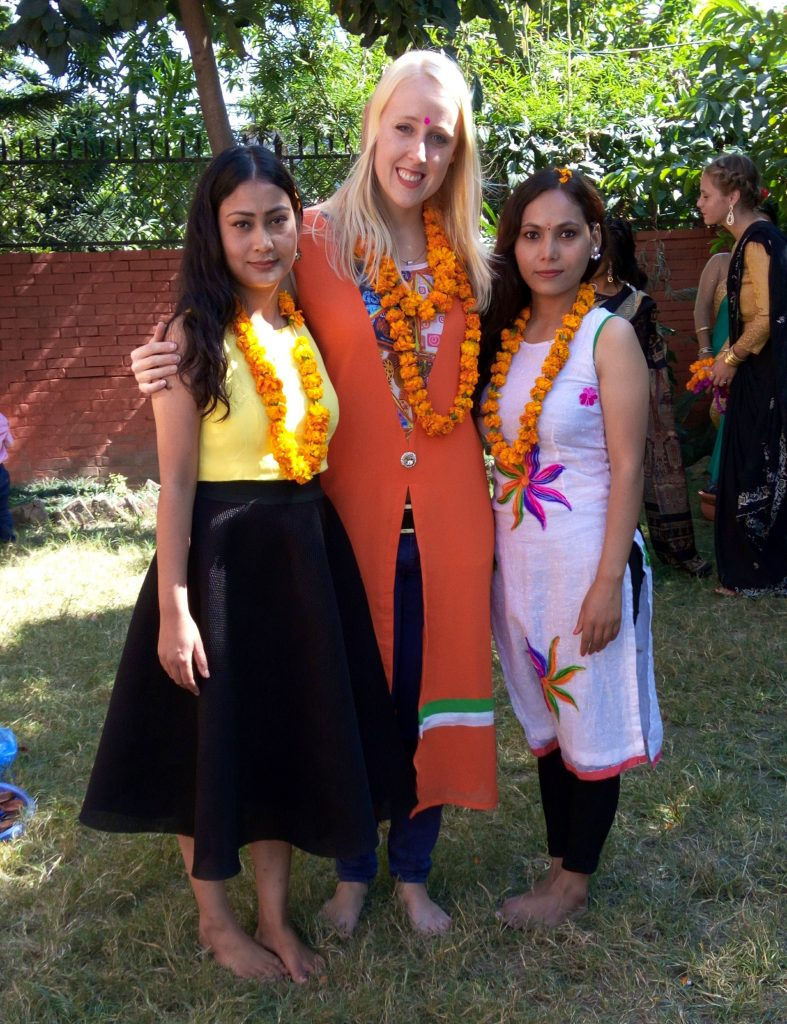 Me with Chet and her sister and traditional Nepali clothes